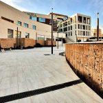 Aura-centro-commerciale-Roma-pavimentazione-pietra-sinterizzata-Duomo-Travertino-Beige