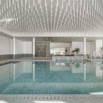 Residence-Hotel-Ambiez---pietra-sinterizzata-L'ALTRA-PIETRA-Harena-Calanca-Light-40x120-2