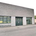 Rivestimento-in-pietra-sinterizzata-uffici-servizi-di-sicurezza-Monza-Brianza-L'Altra-Pietra-Colosseo-Toscano-Harena-Calanca-Dark